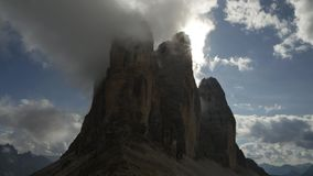 Timelapse clouds over Tre Cime di Lavaredo, Dolomite. Fast moving clouds over the peaks of the Dolomite Mountains, near Cortina D'Ampezzo stock footage