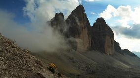 Timelapse clouds over Tre Cime di Lavaredo, Dolomite. Fast moving clouds over the peaks of the Dolomite Mountains, near Cortina D'Ampezzo stock video footage