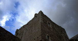 Timelapse of clouds passing over castle tower stock video footage