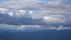 Timelapse of clouds over the Carpathian Mountains. Timelapse clouds on a spring day over the Carpathian Mountains stock footage