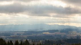 Timelapse of clouds and sunrays over Chehalem Mountains and Tualatin Valley OR stock video footage