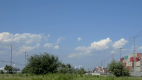 Timelapse of cloudscape over the industrial area. stock video footage