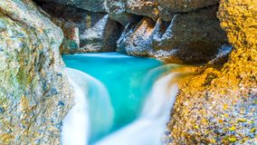 4K Timelapse. A colorful waterfall and a lake in a cave. Mountains of Central Asia. Timelapse. A colorful waterfall and a lake in a cave. Mountains of Central stock video footage