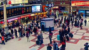 Timelapse of Commuters inside Victoria Railway Station in London, UK stock video footage