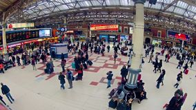Timelapse of Commuters inside Victoria Railway Station in London, UK. LONDON, UNITED KINGDOM - DECEMBER 1, 2013: Top View timelapse of Commuters inside Victoria stock video footage