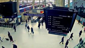 Timelapse of Commuters inside Waterloo Railway Station in London stock footage