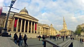 Timelapse of commuters on Trafalgar square National Gallery in London, UK stock video footage