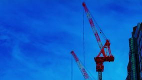 A timelapse of cranes at the under construction on the building in Tokyo stock video
