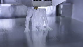 Timelapse of 3D printer print the human like monkey using plastic filament