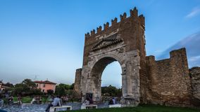 Timelapse day to night of the Ancient Arch of Augustus. This is the oldest Roman arch which sur stock video