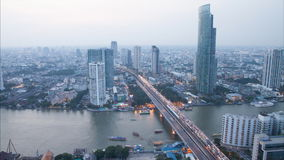 Timelapse day to night hight view of Bangkok city with modern building at evening untill sunset stock video