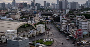 Day to night passing cloud and traffic on road near Bangkok Railway Station stock footage