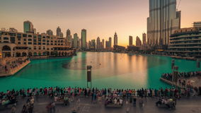 Timelapse day translation to night view Dubai dancing fountain show from Burj Khalifa, Dubai. 4K Timelapse in Dubai, United Arab Emirates stock footage