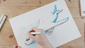 Timelapse des Künstlers ein Flugzeugfliegen zeichnend lizenzfreie abbildung