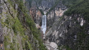 Timelapse - Distant shot of a big waterfall in the mountains stock video footage