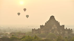 Timelapse of Hot air balloon over plain of Bagan in misty morning before sunrise, Myanmar Stock Footage