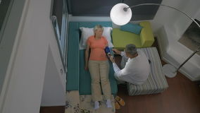 Timelapse of doctor visiting woman at home stock video footage