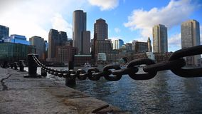 Timelapse of the downtown Boston skyline as view from Seaport stock video footage