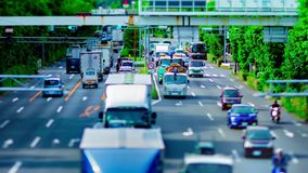 A timelapse of downtown street at Kanpachi avenue in Tokyo daytime tilt-shift panning. A timelapse of downtown street at the avenue tilt-shift panning. Setagaya stock footage