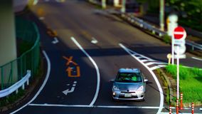 A timelapse of downtown street at Kanpachi avenue in Tokyo daytime tilt-shift tilting. A timelapse of downtown street at the avenue tilt-shift tilting. Setagaya stock video