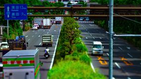 A timelapse of downtown street at Kanpachi avenue in Tokyo daytime tilt-shift. A timelapse of downtown street at the avenue tilt-shift. Setagaya district Tokyo stock footage