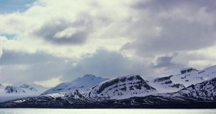 Timelapse of dramatic clouds over mountains in the arctic stock video footage