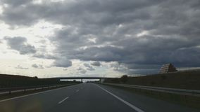 Timelapse of driving on freeway on summer day. Sun hides behind low dark clouds. Stock footage stock video footage