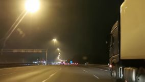 Timelapse of driving on the A2 near Nieuwegein, Utrecht during night time, highway drive in the Netherlands, 20 November, 2019. A timelapse of driving on the A2 stock footage