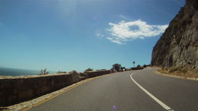 Timelapse driving up Chapman's Peak stock video