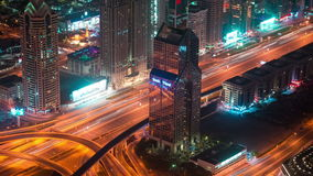 Timelapse Dubai downtown architecture at night. Aerial view of the Sheikh Zayed road with fast moving traffic. 4K Timelapse in Dubai, United Arab Emirates stock footage