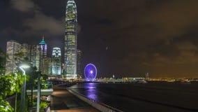 Timelapse e Hong Kong Observation Wheel da noite de Skycrapers, que é a atração turística a mais atrasada na cidade filme