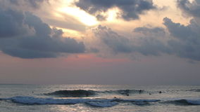 Timelapse of evening surfers stock footage