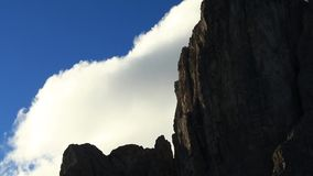 Timelapse with fast moving clouds over peaks in Dolomite stock footage