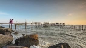 Timelapse of fishing jetty during big wave stock footage