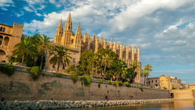 Timelapse with flying clouds over Cathedral of Palma de Mallorca and Almudaina Castle stock video footage