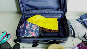 Timelapse of open suitcase with clothes. Timelapse footage of open suitcase with clothes and personal things prepared for travelling. Shot in 4k resolution stock footage