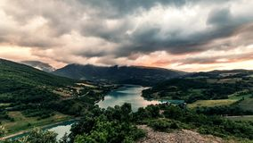 Timelapse gold sunset on mountain lake. Fast clouds, dramatic sky. 4K stock video