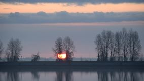 Timelapse of gorgeous sunrise over lake or river stock footage