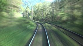 Timelapse of high speed train passing fast through the mountains and green forest. UHD 4K stock video footage
