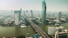 Timelapse hight view of Bangkok city with modern building,that cover with mist, and traffic stock video