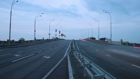Timelapse of highway road junction, city vehicles pass lights on. Stock footage stock footage