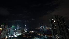 Timelapse of Hong Kong in night time. Timelapse shot of night life in Hong Kong. City panorama with illuminated buildings, Symphony of Lights, traffic in harbour stock video footage