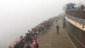 Hundreds of photographers in mist waiting to take photos at Yuanyang rice-paddy terrace. Timelapse : Hundreds of photographers in mist waiting to take photos at stock footage