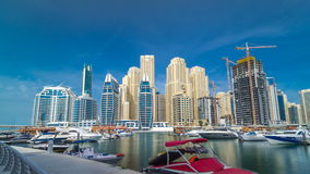 Timelapse hyperlapse of business city in Dubai marina at waterfront. View on Dubai Marina from pier. Timelapse hyperlapse of business city in Dubai at waterfront stock footage
