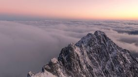 Sunrise over the mountains inversion. Timelapse 4K sunrise illuminated the shields of the mountains and the low inverse clouds that covers the landscape stock footage