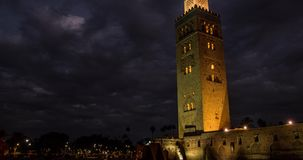 Timelapse Koutoubia Mosque in Marrakech at sunset and night on background of clouds, Morocco stock footage