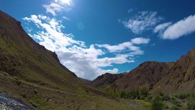 Timelapse landscape with clouds moving over mountains - Altay Russia, 4k stock video