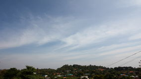 Timelapse of landscape in thailand, hills with houses with cloudy blue sky. stock video