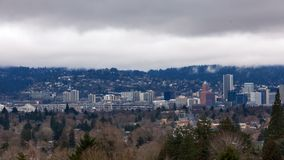 Timelapse of low white clouds over city skyline and auto traffic downtown Portland Oregon one winter day 4k uhd. Timelapse movie of moving low white clouds over stock video