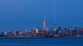 Timelapse of Lower Manhattan at dusk with the two beams of lights from the Tribute in Light. New York City. Timelapse of Lower Manhattan at dusk with the two stock video